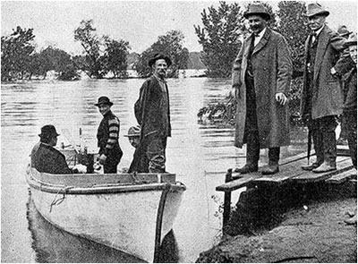 Graeber stands in front of the boat in 1903